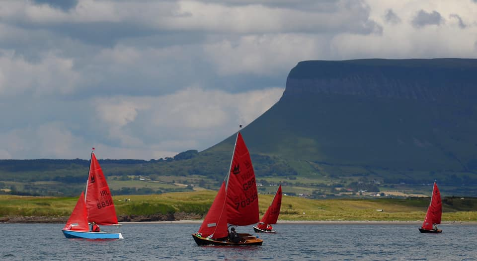 4 mirrror sailing dingies in front of benbulben